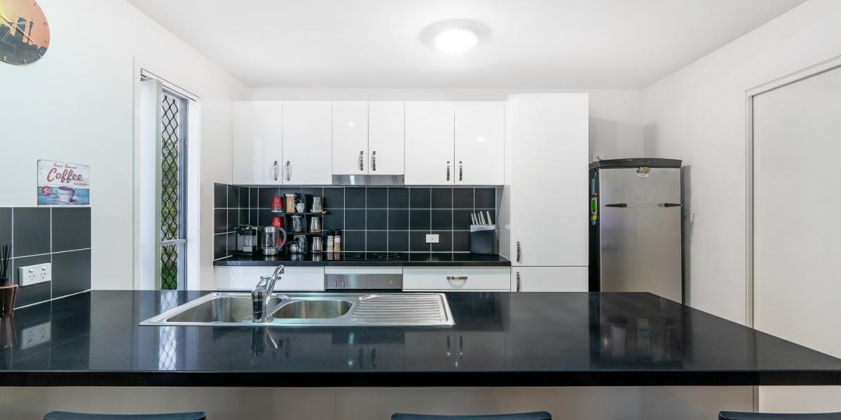 Spacious 4 bedroom townhouse is yours for the taking !!!!