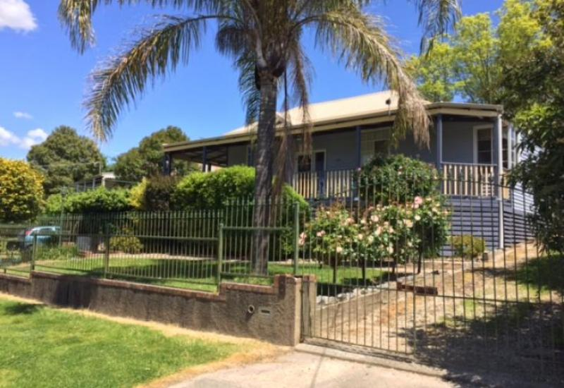 Renovated four (4) bedroom home set on popular Queen Elizabeth Drive, just a short drive to main street shops with water front views.