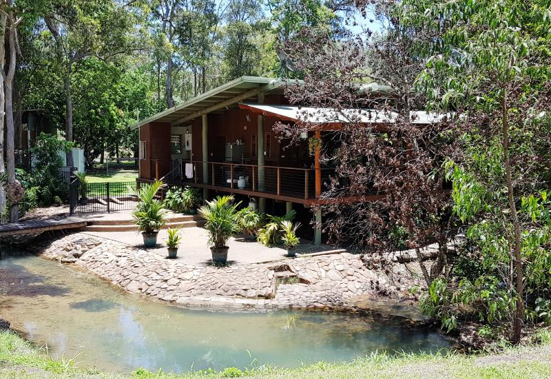 Outstanding three bedroom pole home on the banks of a seasonal creek.