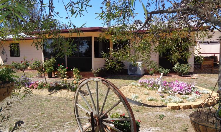 Rural Setting - Very Tidy Home with Great Sheds