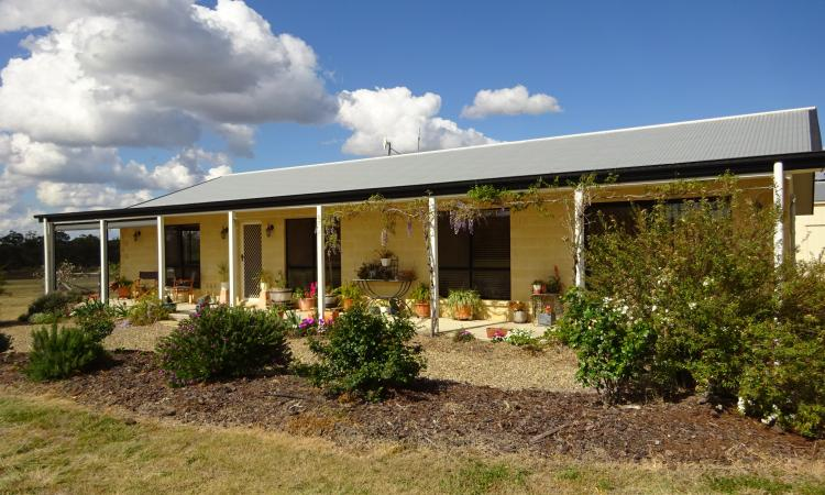 High Quality Brick Home on 15 Acres with Great Shed Space