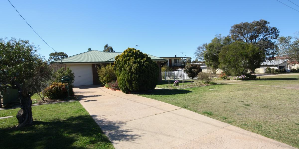 Appealing & Immaculate Brick Home With Sheds