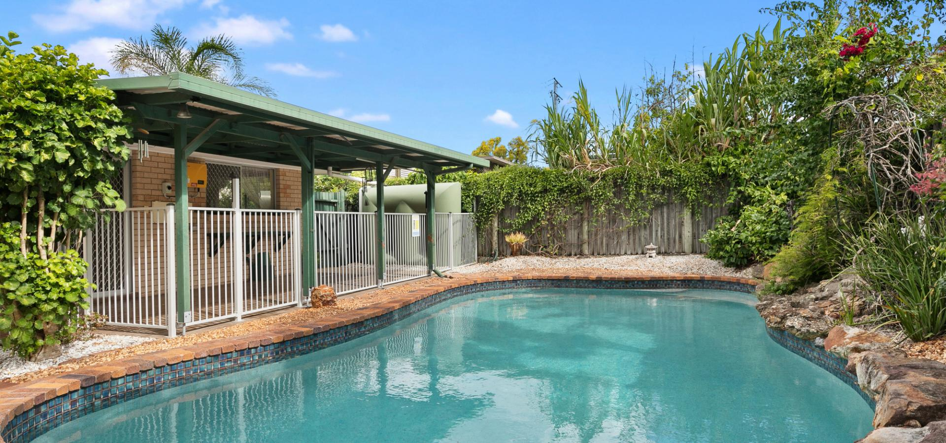 Lowset home with tropical inground pool