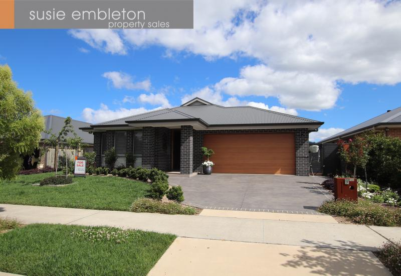 A QUALITY HOME WITH PROFESSIONALLY LANDSCAPED GARDENS