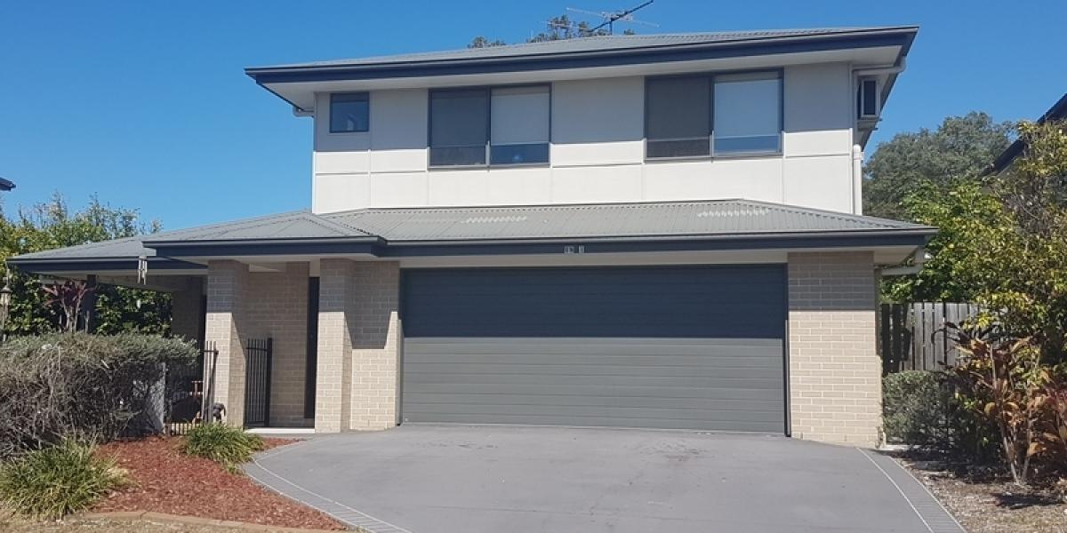 Unique Townhouse with Street Frontage & Own Driveway – Great Return!