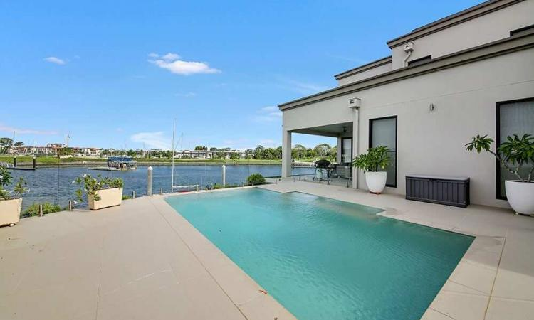 Private world-class waterfront residence at the Sanctuary Cove Point ***Corner lot! ***