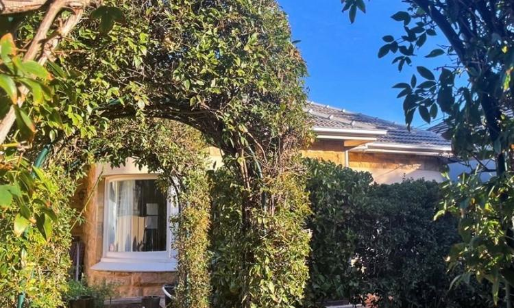 WELL LOCATED IN LOVELY TREE LINED SURROUNDINGS