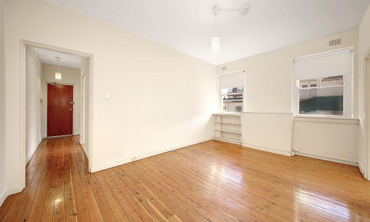 CHARACTER FILLED TWO BEDROOM + SUNROOM APARTMENT WITH LOCK UP GARAGE!!