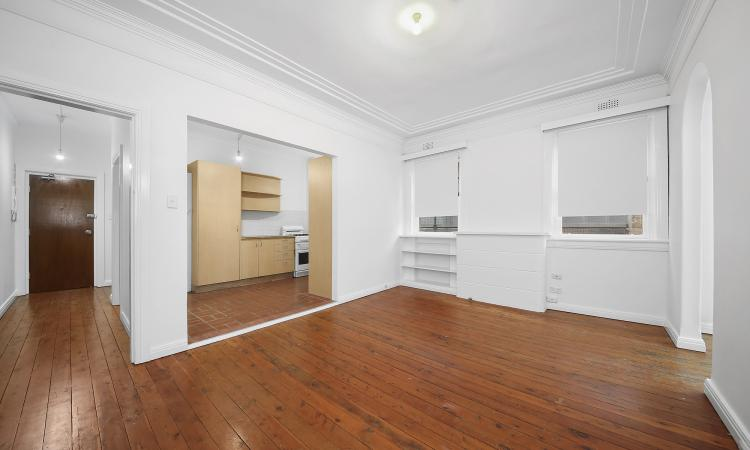 NORTH FACING AND BRIGHT TWO BEDROOM + SUNROOM APARTMENT WITH ONE CAR SPACE