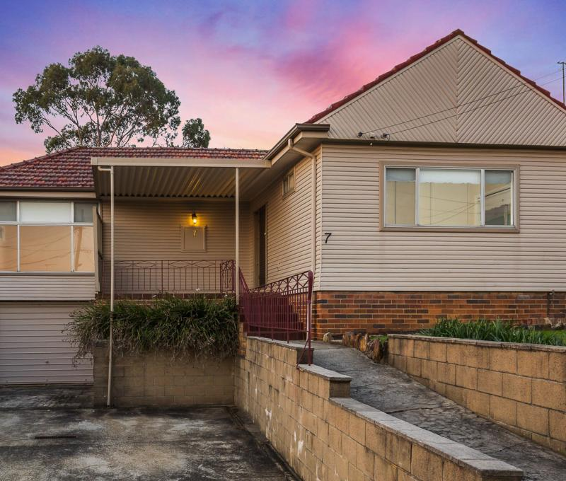 Warm and Sunny 3 Bedroom Home on the High Side of an Awesome Street!