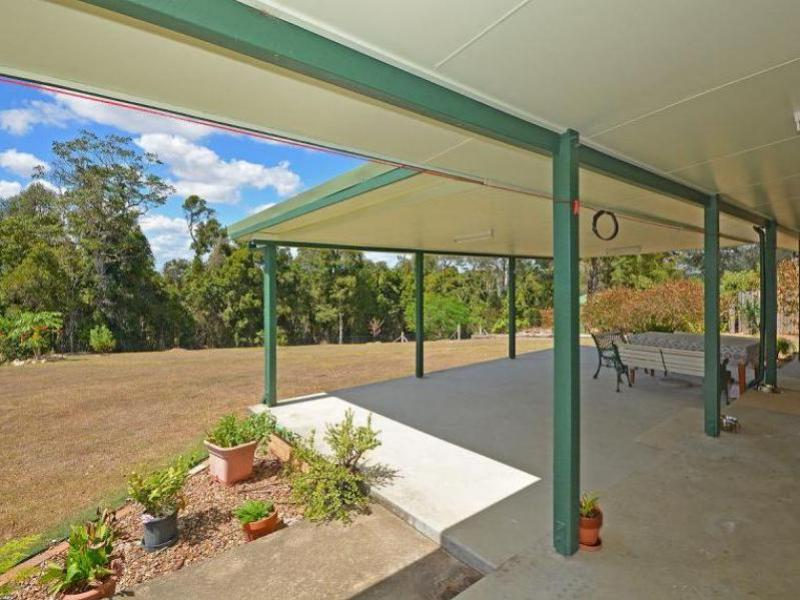DISTANT SEA VIEW, ELEVATED POSITION, 4437 SQM OF CLEARED LAND, DOUBLE SHED WITH CARPORT AND SEPARATE TRIPLE CARPORT.