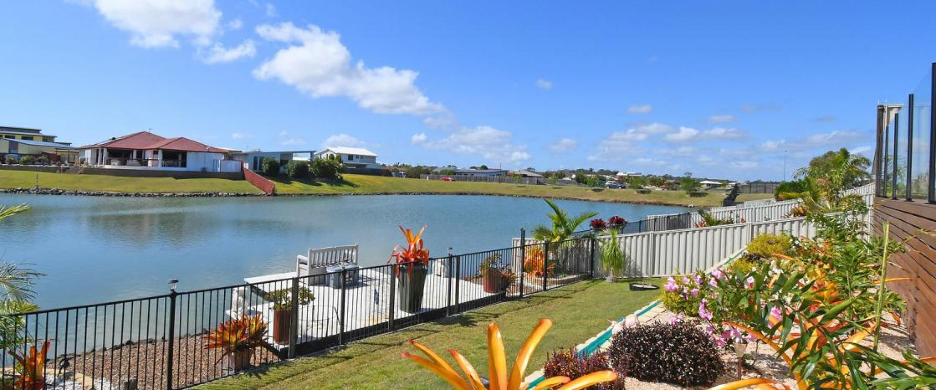 WATERFRONT PREMIER PROPERTY WITH A JETTY ELEVATED 7 x 3 PEBBLECRETE SWIMMING POOL, 6 x 3.5 SHED, 9 x 3.5 CARAVAN PORT, 6.6kW SOLAR SYSTEM, DUCTED A/C.
