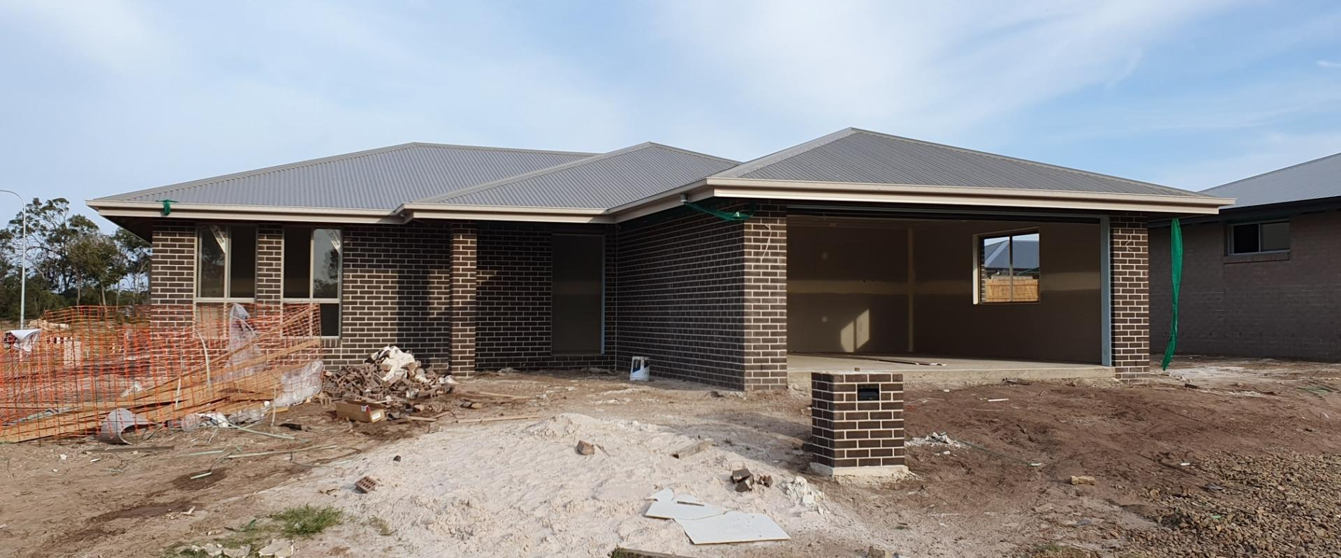 BRAND NEW FAMILY HOME WITH EXECUTIVE INCLUSIONS: STONE BENCHTOPS AND DISHWASHER, AIR CONDITIONING, FULL TURF, HORIZONTAL PALINGS GATES & RETURNS.