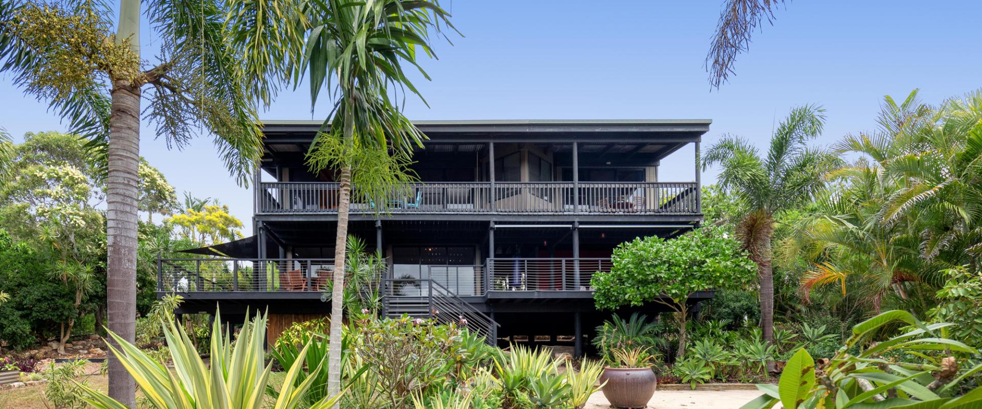 SITTING UP HIGH A TRULY MAGNIFICENT ELEVATED RESIDENCE WITH BREATHTAKING AND SPECTACULAR TREE TOP CANOPY VIEWS INC DISTANT SEA AND FRASER ISLAND VIEWS