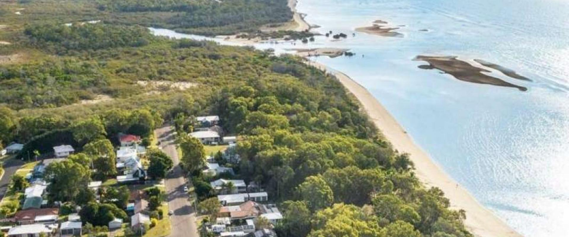 WALK DIRECTLY ONTO THE RUSTIC SANDY BEACH FROM YOUR BACK YARD, CHARACTER RAISED QUEENSLANDER, WIDE ALFRESCO ENTERTAINMENT DECK, DOUBLE SHED WORKSHOP.