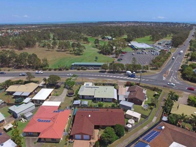 GOLFERS DELIGHT OPPOSITE HERVEY BAY 18 HOLE GOLF COURSE, DOUBLE TANDEM SHED AND A SINGLE SHED OR WORKSHOP, LEFT SIDE CARAVAN, BOAT AND TRAILER PARKING