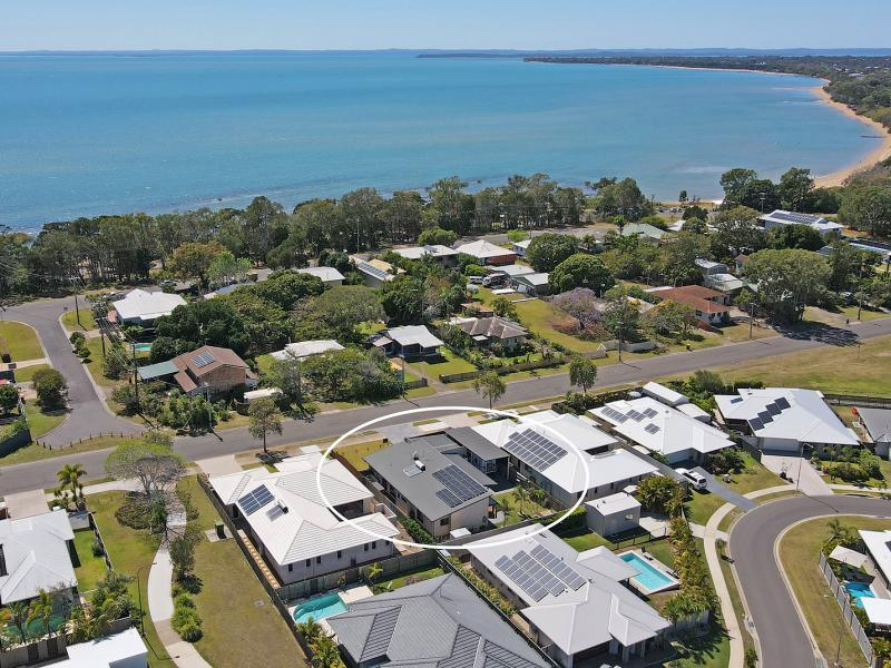 SUPERB PENINSULAR LOCATION, WALK TO THE BEACH, PURPOSE BUILT DRIVE THROUGH CARAVAN OR BOAT PORT, 6.5 KW SOLAR SYSTEM, BUTLERS PANTRY, MEDIA OR 4th RM.