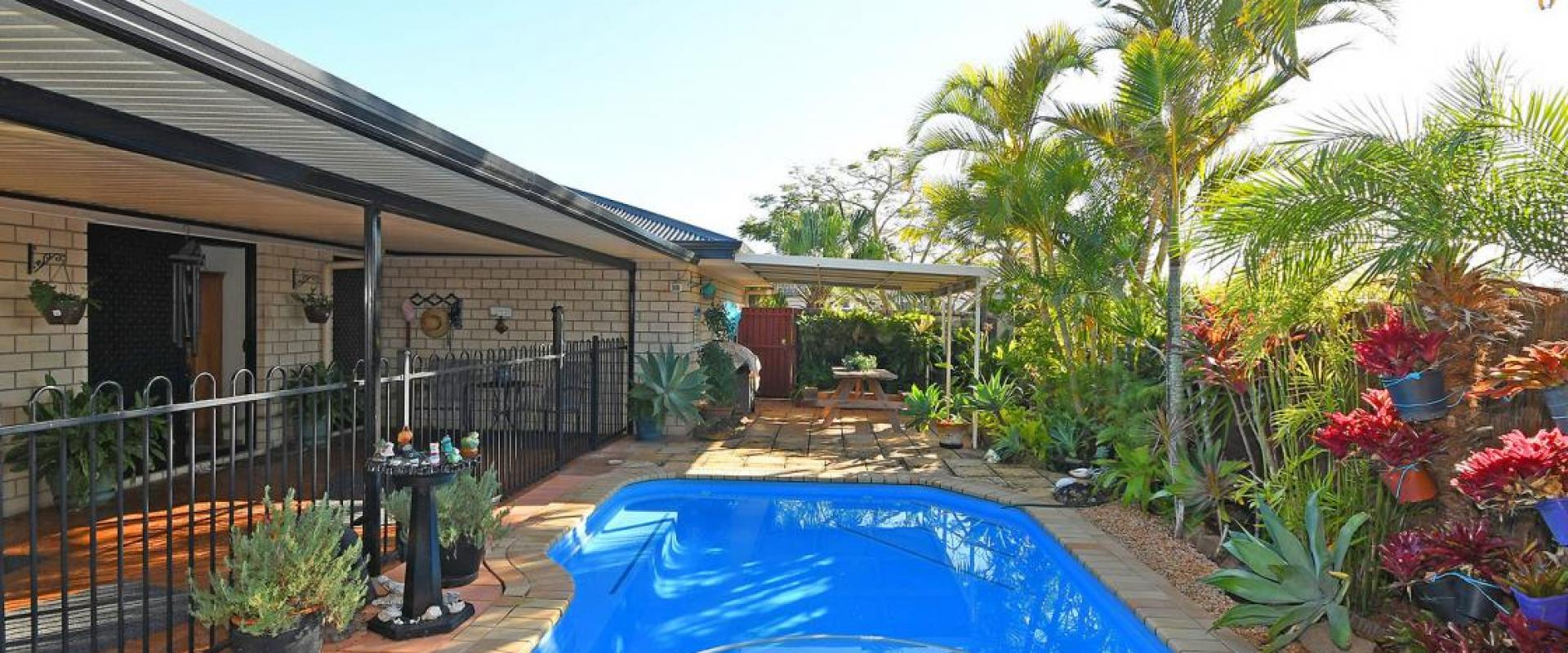 CORNER 811 SQM BLOCK, PRIVATE SWIMMING POOL, 6 x 6 DOUBLE SHED, AMPLE CARAVAN AND BOAT PARKING, 2 LIVING ROOMS, LARGE COVERED ALFRESCO, SOLAR H WATER