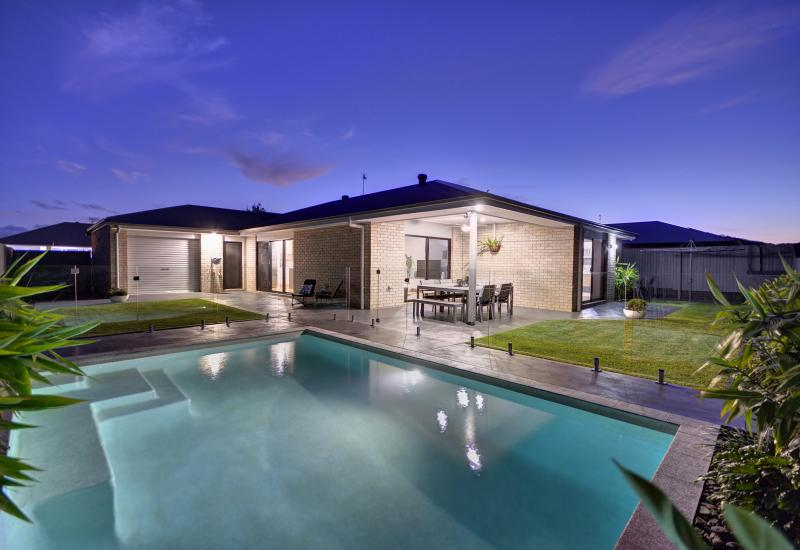 BE THE ENVY OF ALL YOUR FRIENDS! THIS IMMACULATE, MODERN HOME HAS IT ALL - SPARKLING IN-GROUND POOL, TRIPLE LOCK-UP GARAGE AND A FANTASTIC FLOOR PLAN!