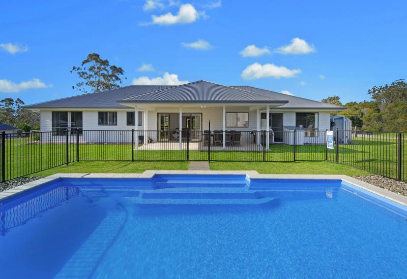 Contemporary acreage living in quiet location