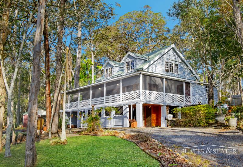 Distinctive home with separate studio on 3.8 acres in ideal location