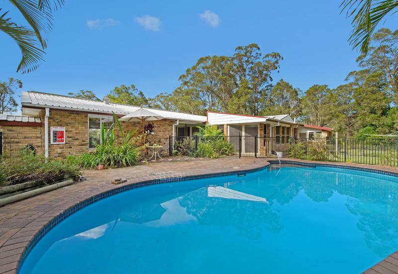 Established home and pool on 1.4 acres