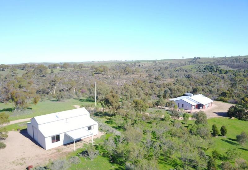 MODERN HOME IN THE PICTURESQUE BEETALOO VALLEY ON 85 ACRES