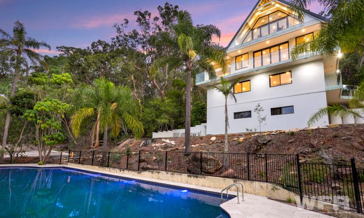 Resort Living on 4 Acres of Waterfront Land